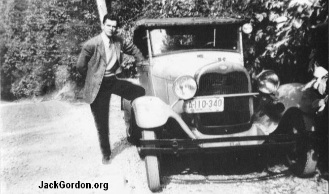 Jack Gordon in a car by the side of the road